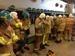 Students change into firefighting gear